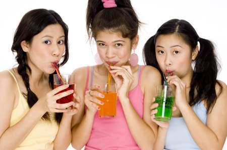 fizzy: Three cute asian women drinking colorful fizzy sodas