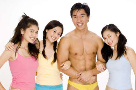 Three young asian women with a muscular man photo