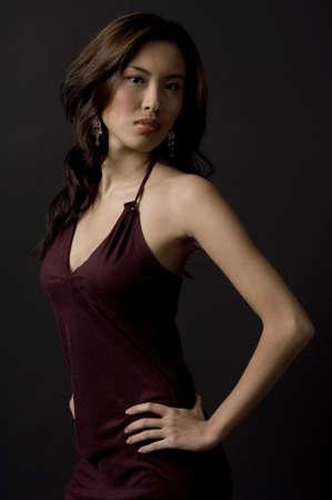 demure: A beautiful asian model in a velvet evening dress