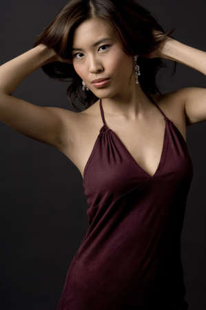 demure: A beautiful young chinese woman in an evening dress