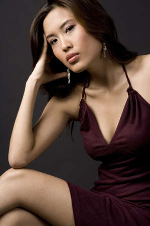 demure: A beautiful portrait of an asian model in a sitting pose