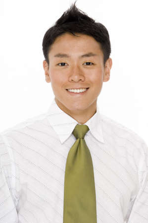 A young chinese businessman in white shirt green tie on white background Stock Photo - 430892