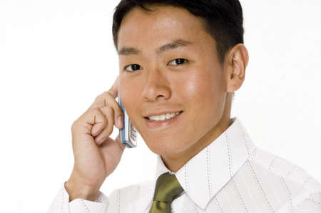 A handsome young businessman talking on a phone Stock Photo - 430860