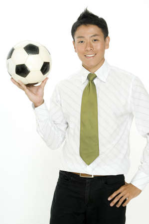 A young businessman takes his football to work with him photo