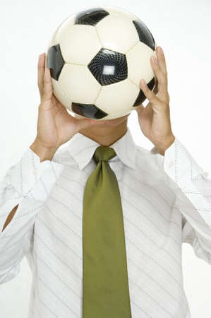 replaces: A young man replaces his head with a soccer ball