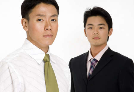 A young asian businessman standing in front of a colleague photo