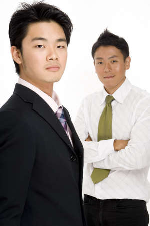 Two asian businessmen on white background (focus on man in front) photo