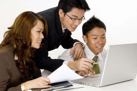 A smiling business group of young asian executives photo