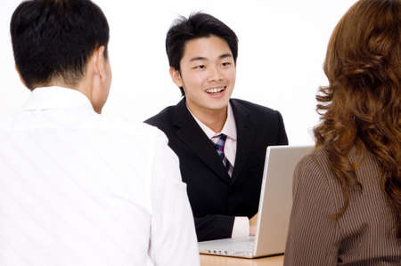 recieve: A young couple recieve some helpful advice from a happy advisor Stock Photo