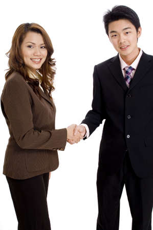clinch: Two good-looking business executives shaking hands Stock Photo