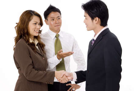 A businesswoman is introduced to a young businessman
