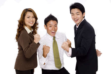 A young asian business team celebrates