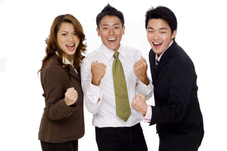 Three young executives punch the air in celebration Stock Photo - 486376