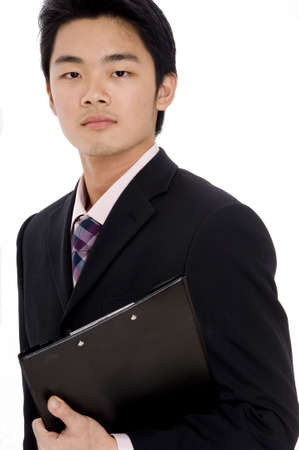 A young chinese businessman in suit on white background Stock Photo - 486372