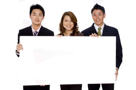 Three young asian business people hold up a large blank sign