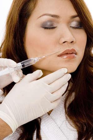 hygenic: A young woman undergoes Botox surgery Stock Photo