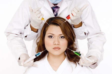 A woman with four hands holding syringes with different colored liquids photo