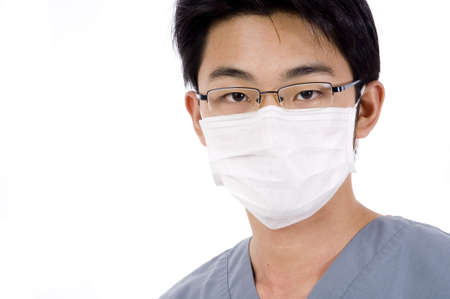 operation gown: A young asian man in medical scrubs and face mask