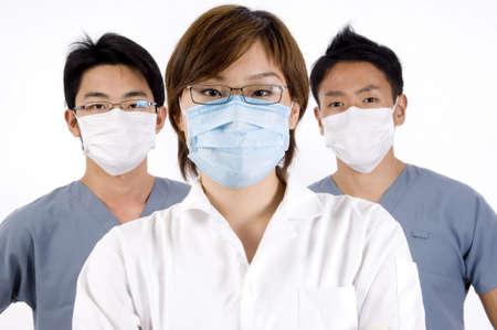 operation gown: Profesional de tres healthcare en el fondo blanco Foto de archivo