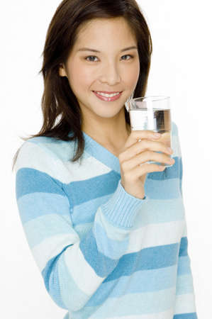 woman sweater: A pretty young asian woman with glass of water in hand