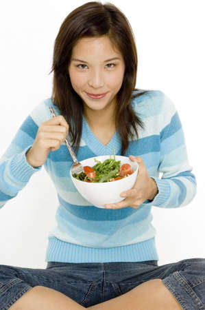 A young asian woman with a bowl of salad photo