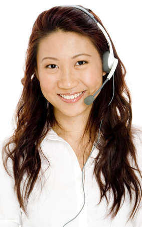 A beautiful young asian woman wearing a headset with microphone Stock Photo