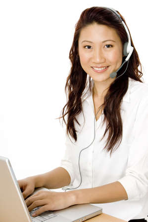 An attractive young asian woman with a helpful smile Stock Photo