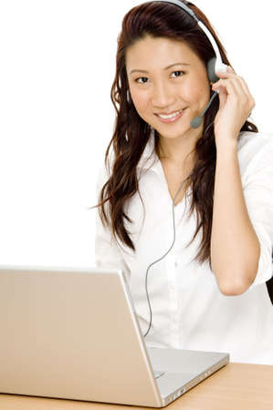 A pretty young asian woman with laptop and headset photo