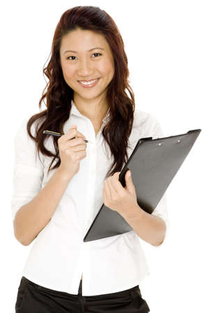 A pretty asian businesswoman carrying a clipboard Stock Photo