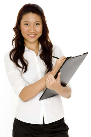 A pretty young asian businesswoman with clipboard Stock Photo