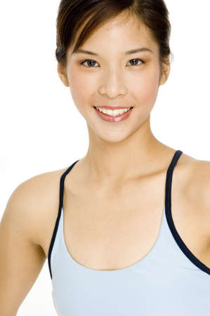 A pretty young asian fitness trainer in blue sports top on white background