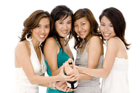 Four pretty young asian women opening a bottle of champagne Stock Photo - 502512
