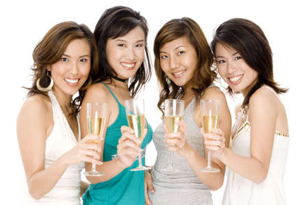 Four attractive young asian women drinking glasses of champagne Stock Photo - 502506