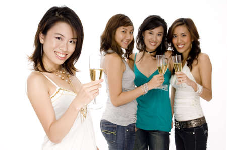 A pretty young asian woman drinks champagne with friends stood behind Stock Photo - 502514
