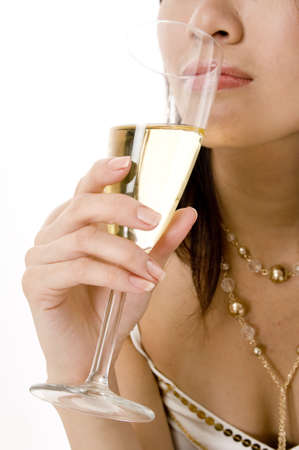 A young woman drinking champagne Stock Photo