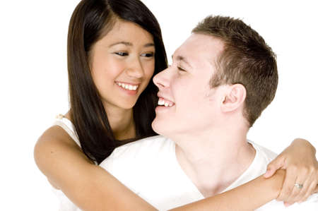 A young couple very much in love looking into each others eyes