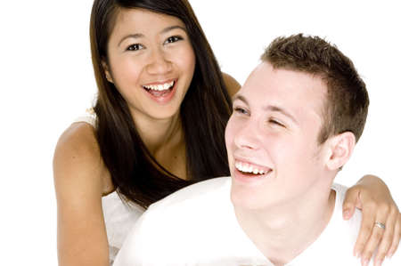 A young couple in love share a joke and a smile