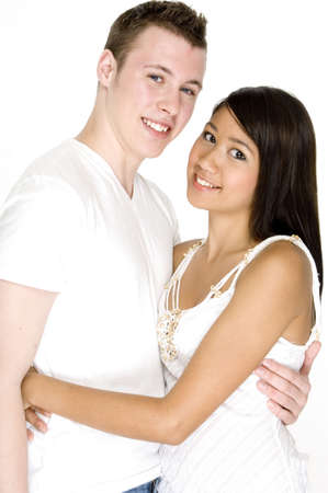 A teenage couple wearing white on white background photo