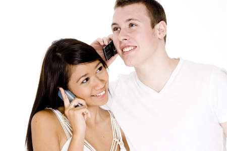 An attractive young couple talking on cellphones Stock Photo