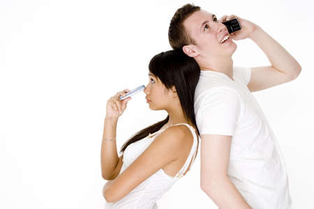 A young woman looks left out as her boyfriend talks on the phone photo