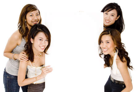 Four pretty asian women with a blank space in between them Stock Photo - 502601