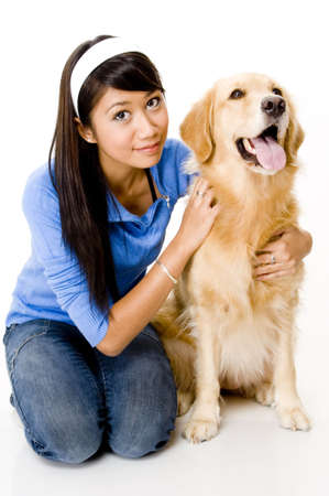 retreiver: A pretty young asian woman with a big dog