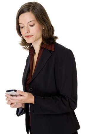 A young female business executive using a portable handheld device photo
