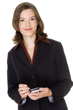 An attractive young businesswoman holding a handheld computer on white background photo