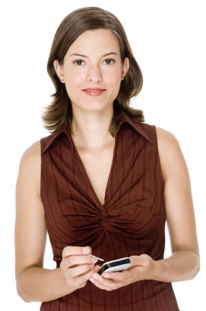 An attractive young woman in a short-sleeve blouse with mobile device photo