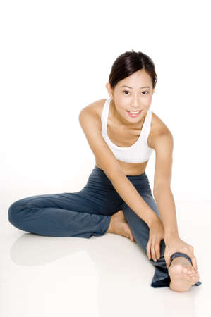 hamstring: A young asian sporty woman stretches her hamstring Stock Photo
