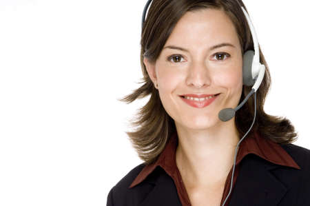 An attractive young woman in business suit wearing headset