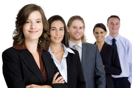 An attractive young woman heads up a young business team of professionals (shallow depth of field) Stock Photo