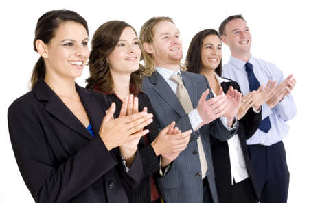 applauding: A successful business team applauding on white background