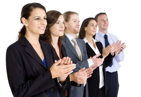 applauding: A dynamic business team applauding their success on white background